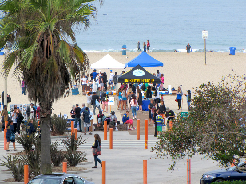 "Looking down the hill towards the beach at Bay Street on Coastal Cleanup Day 2013 at some of the cultural exhibits, volunteers' registration area, and the ""Inkwell"" landmark monument just before the almost 700 people show up for a day of education and community action. Saturday, September 21, 2013, Santa Monica, California. Photograph courtesy of Heal the Bay. (Click to enlarge)"