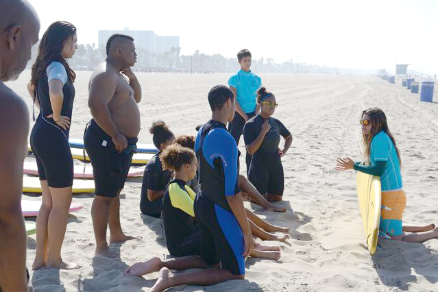 Surf Instructor Mattie of Surf Bus Academy begins the safety talk and surf lessons on the sand with Claremont Colleges' students. Claremont University Consortium/Office of Black Student Affairs Incoming Student Retreat, September 15, 2013, Santa Monica, California, photo by Travis Brown. (Click to enlarge)
