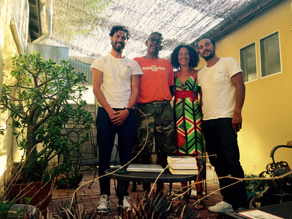 "Rick Blocker, surfer; Alison Rose Jefferson, historian; Levi Masoet and Ebrahim Hajee, The Forgotten Surfer Project. Levi and Ebrahim came to visit, share information and gain knowledge about African American surfers. They are working on an exhibit and film project on South African surfers of color called ""The Forgotten Surfer."" Garden of Alison Rose Jefferson's house in Los Angeles, California. 4 September 2015. (click to enlarge)"